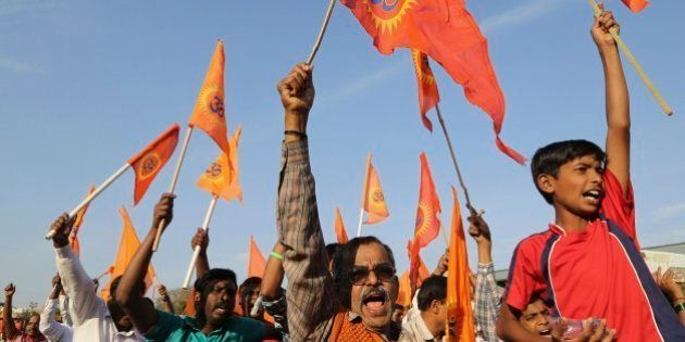 Supporters of right-winged Vishwa Hindu Parishad (VHP) or World Hindu Council raise flags and shout slogans...