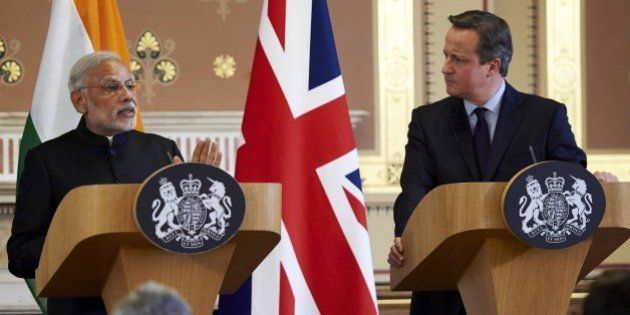 India's Prime Minister Narendra Modi (L) and British Prime Minister David Cameron give a joint press...