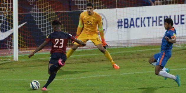 India's goalie Gurpreet Singh Sandhu (C) and player Arnad Kumar Mondal (R) look on as Guam's Shane Andre...