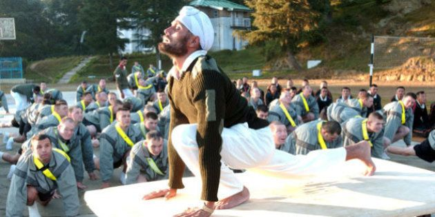 Sgt. Gurdev Singh, a Indian Army master physical fitness instructor, leads Soldiers from C Company, 3rd...