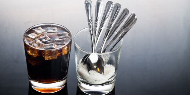 Concept of fizzy cola drinks with unhealthy sugar