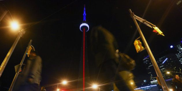TORONTO, ON - NOVEMBER 13 - The CN Tower lit up with the colours of the French Flag in support of France...