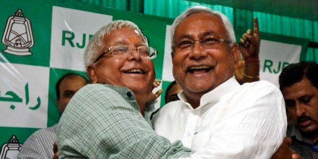 PATNA, INDIA - NOVEMBER 8: RJD Chief Lalu Prasad Yadav and Nitish Kumar celebrate after Mahagathbandhan's...