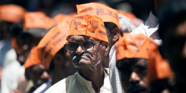 Supporters of the Bharatiya Janata Party (BJP) stand in line to hear Indian Prime Minister Narendra Modi...