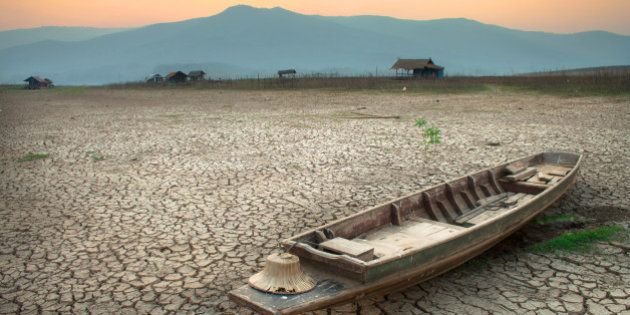 The wood boat on cracked earth, metaphoric for climate change and global