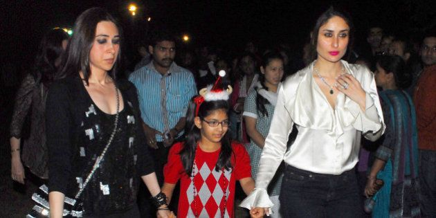 MUMBAI, INDIA - DECEMBER 24: Indian bollywood actresses Kareena Kapoor and Karisma Kapoor with her daughter...