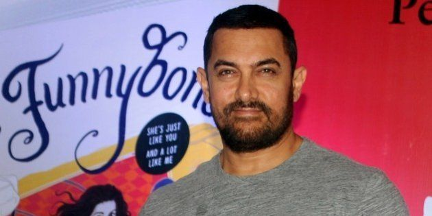 Indian Bollywood actor Aamir Khan poses for a photograph during the launch of the 'Miss Funnybones' book...