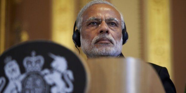 India's Prime Minister Narendra Modi takes part in a joint press conference with British Prime Minister...