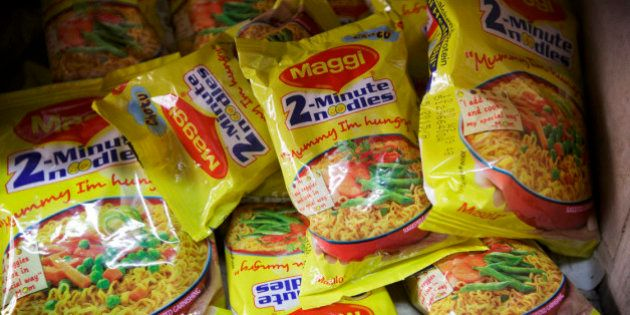 Packets of Maggi 2-Minute Noodles, manufactured by Nestle India Ltd., sit behind the counter at a store...