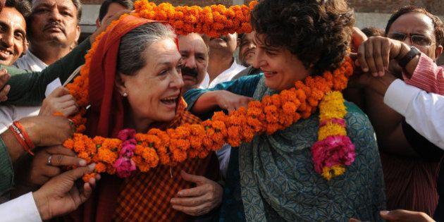 RAE BARELI, INDIA - MAY 28: Congress President Sonia Gandhi and daughter Priyanka Gandhi welcomed by...