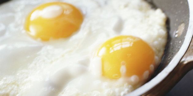 Close-up of eggs being cooked in a