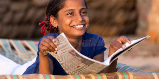 India, Uttar Pradesh, Agra, young girl studying school