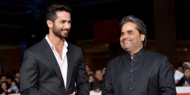 Indian actor Shahid Kapoor (L) poses on the red carpet with Indian director Vishal Bhardwaj before the...