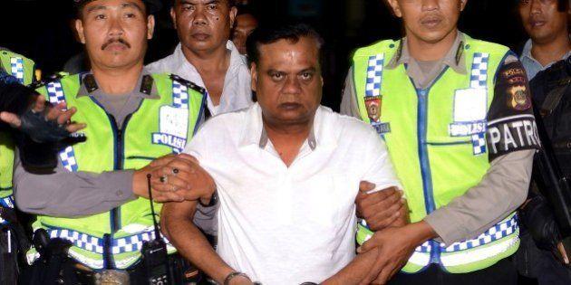 Indonesian police escort Indian national Rajendra Sadashiv Nikalje, 55, known in India as Chhota Rajan,...