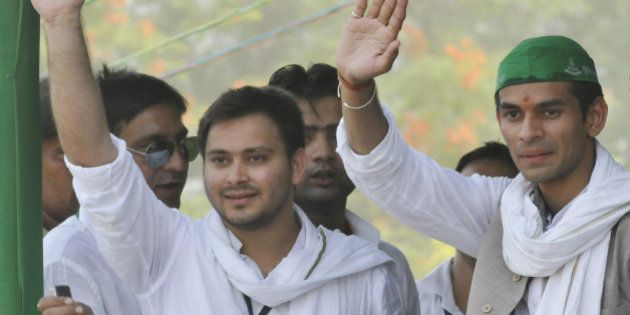 PATNA, INDIA - MAY 15: RJD Chief Lalu Prasad Yadav and Rabri Devi's sons Tej Pratap and Tejashwi Yadav...