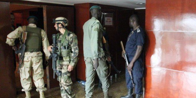 Malian soldiers and special forces stand guard at the entrance the Radisson Blu hotel in Bamako on November...