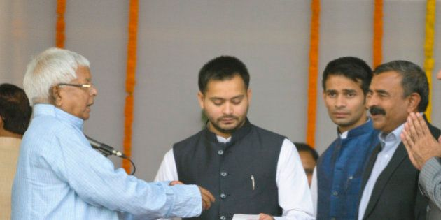 PATNA, INDIA - NOVEMBER 20: RJD Chief Lalu Yadav with his sons Tejasvi Yadav and Tej Pratap Yadav after...