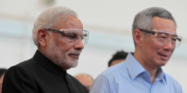 Indian Prime Minister Narendra Modi, left, and Singapore Prime Minister Lee Hsien Loong wear safety goggles...