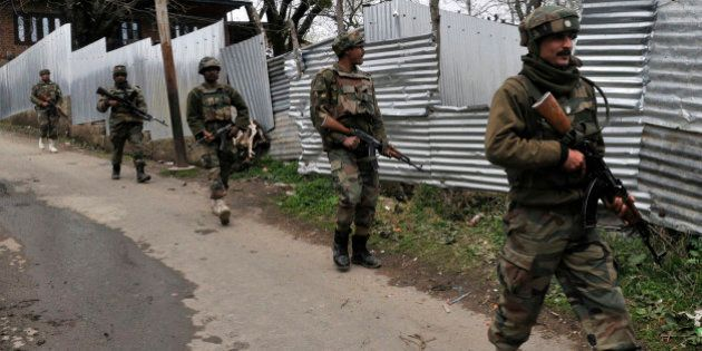 SRINAGAR, INDIA - APRIL 2: Army soldiers carry out a search operation for suspected militants during...