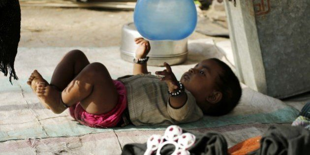 AJMER, INDIA - 2015/05/10: A baby playing balloon on the occasion of 'Mothers Day'. (Photo by Anand Sharma/Pacific...