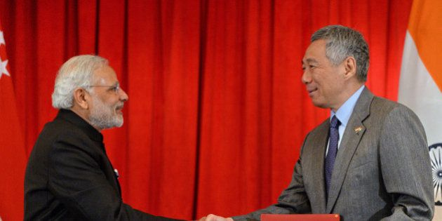 India's Prime Minister Narendra Modi (2nd L) and Singapore's Prime Minister Lee Hsien Loong (R) exchange...
