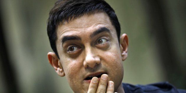 Bollywood actor Aamir Khan gestures during a press conference to promote his new