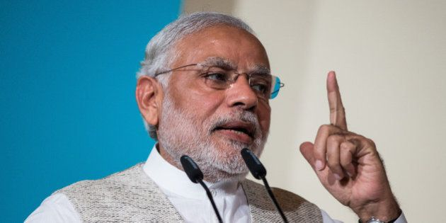 Narendra Modi, India's prime minister, gestures whilst speaking during the 37th Singapore Lecture held...