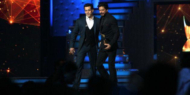 MUMBAI, INDIA -JANUARY 16: Bollywood actor Salman Khan and Shah Rukh Khan at the stage of Star Guild...