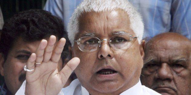 New Delhi, INDIA: Indian Railway Minister and President of the Rashtriya Janata Dal (RJD) party Lalu...