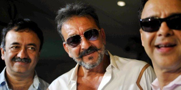 Indian Bollywood film actor Sanjay Dutt (C), director Rajkumar Hirani (L) and producer Vidu Vinod Chopr...