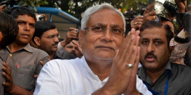 Bihar Chief Minister Nitish Kumar greets supporters after victory in Bihar state elections in Patna,...