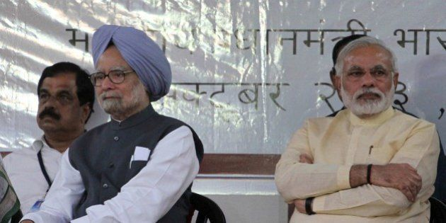 Indian Prime Minister Manmohan Singh, second left, and Gujarat state chief Minister Narendra Modi, right,...