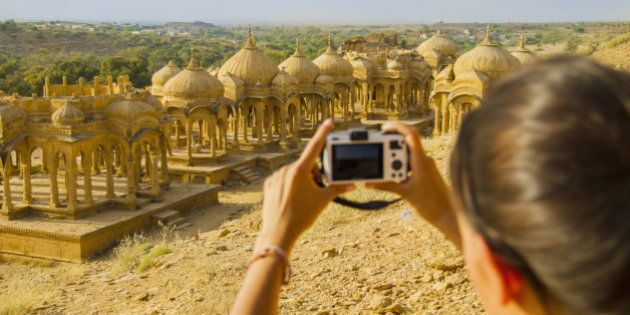 India, Rajasthan,Jaisalmer, Female tourist photographing at Bada Bagh