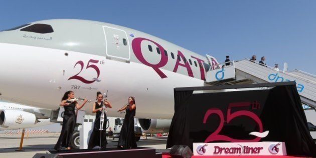 Musicians perform next to the 25th unit of Boeing 787 Dreamliner received by Qatar Airways and dislayed...