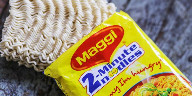 An open packet of Maggi 2-Minute Noodles, manufactured by Nestle India Ltd., are arranged for a photograph...