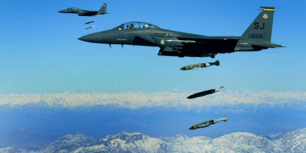U.S. Air Force F-15E Strike Eagles, from the 335th Expeditionary Fighter Squadron, drop 2,000 pound Joint...