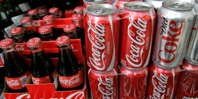 Cans and bottles of Coca-Cola drinks are on display at JJ&F Market in in Palo Alto, Calif., Monday, Feb....