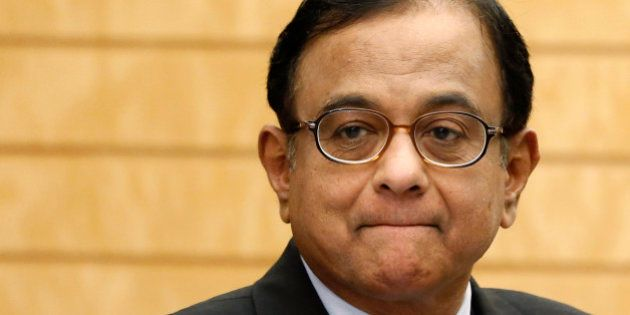 India's Finance Minister Palaniappan Chidambaram waits for arrival of Japan's Prime Minister Shinzo Abe...