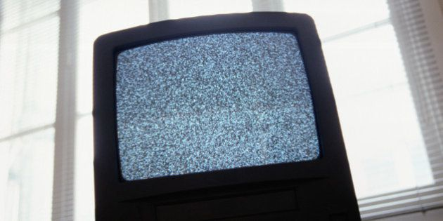 Static on television screen, back lit, low angle