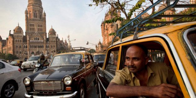 MUMBAI, INDIA - DECEMBER 8: Drivers wait for a passenger in their Premier Padmini taxis outside Chhatrapati...
