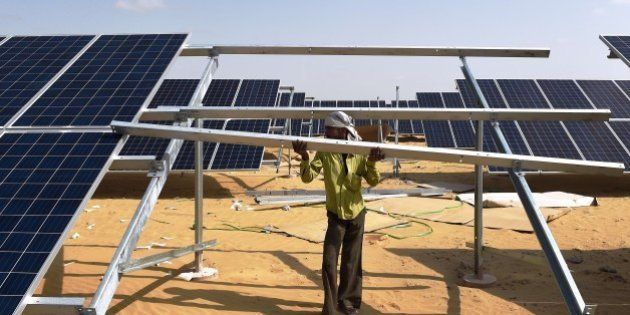 TO GO WITH: Climate-warming-COP21-India-energy-solar, FOCUS by Annie BanerjiIn this photograph taken...
