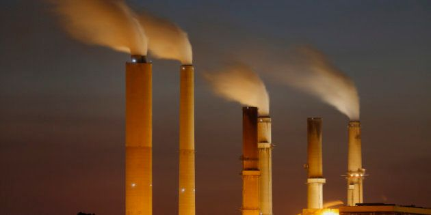 Emissions rise from stacks the Duke Energy Corp. Gibson Station power plant at dusk in Owensville, Indiana,...