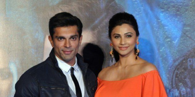 Indian Bollywood actors Karan Singh Grover and Daisy Shah pose during the trailer launch of the upcoming...