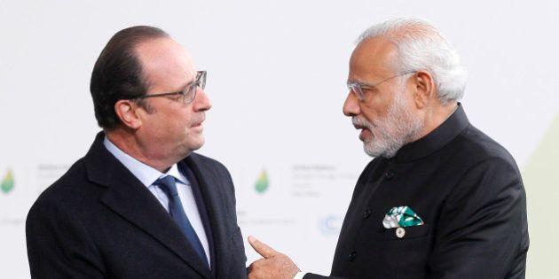 PARIS, FRANCE - NOVEMBER 30: French President Francois Hollande (L) shakes hands with Indian Prime Minister...
