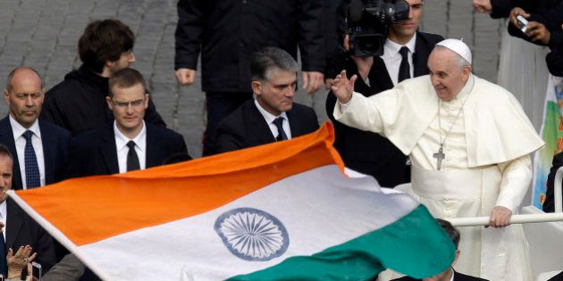 An Indian flag is waved near Pope Francis at the end of the Canonization mass for Eufrasia Eluvathingal,...