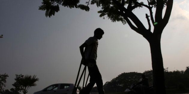 A physically disabled man returns after participating in a walk to mark the International Day of persons...