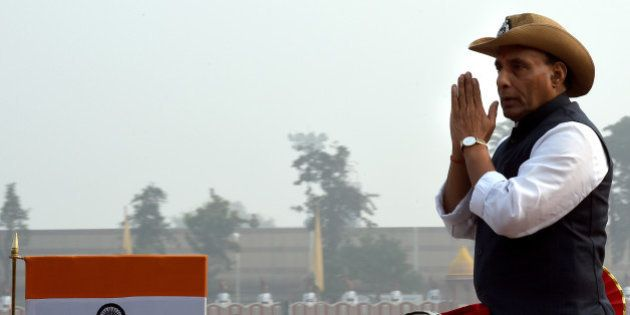 Indian Minister for Home Affairs, Rajnath Singh gestures as he inspects the parade at the start of the...