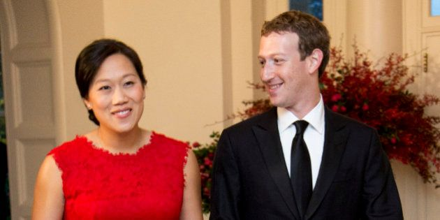 Facebook Chairman and Chief Executive Officer Mark Zuckerberg and his wife Priscilla Chan, arrive for...