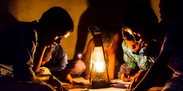 CHOWKIPUR, INDIA, - SEPTEMBER 18: Boys study by lantern light in a house L-R: (children closest to camera) Nitish Suraj (12), Ashish Choudhary (10), Baijunath Paswan (7) in Chowkipur India on September 18, 2015. Chowkipur is a village 60 KM from Patna that has no electricity. (Photo by Simon de Trey-White for the Washington Post)