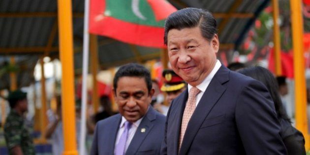 Chinese President Xi Jinping, right, walks with Maldives President Yaamin Abdul Gayoom upon his arrival...